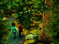 Couple holding hands walking in the forest a scene depicting a loving following stream of water a Stock Photo