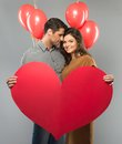 Couple holding paper heart happy handmade and red balloons Stock Photo