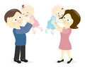 Couple holding up their babies Royalty Free Stock Image