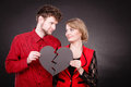 Couple holds broken heart joined in one Royalty Free Stock Photo