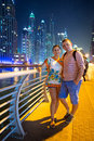 Couple on holidays in dubai city at night Royalty Free Stock Photo