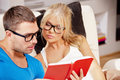 Couple at home with book bright picture of Stock Photo