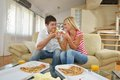 Couple at home eating  pizza Royalty Free Stock Photo