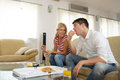 Couple at home eating  pizza Royalty Free Stock Image