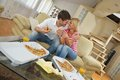 Couple at home eating pizza happy young eat fresh relaxing and watch tv Stock Photography