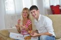 Couple at home eating pizza happy young eat fresh relaxing and watch tv Royalty Free Stock Photography