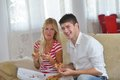 Couple at home eating pizza happy young eat fresh relaxing and watch tv Royalty Free Stock Photos