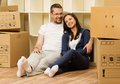 Couple in home interior young positive among boxes their new Stock Photo