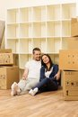 Couple in home interior young positive among boxes their new Stock Image