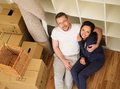 Couple at home young positive among boxes in their new Stock Photos