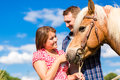 Couple with horse on pony farm Royalty Free Stock Photo