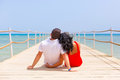 Couple in hug resting on the pier of red sea egypt Royalty Free Stock Images