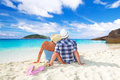 Couple hug sitting together caribbean sea Stock Photos