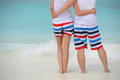 Couple hug together on the beach asian Stock Images