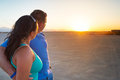 Couple in hug watching together sunset on the desert Royalty Free Stock Images