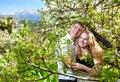 Couple hugging around bloomy trees Royalty Free Stock Photo