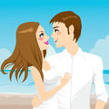Couple hugging on beach romantic the and looking each other happily enjoying honeymoon vacation day Royalty Free Stock Photo