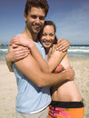 Couple hugging on the beach sandy Stock Image