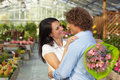 Couple hugging in flower nursery Royalty Free Stock Photo