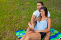 Couple hugging and having picnic in park Royalty Free Stock Photo