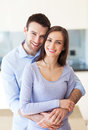 Couple hugging at home young Royalty Free Stock Photos
