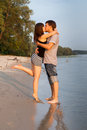 Couple hugging and kissing at riverside Royalty Free Stock Image