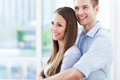 Couple hugging in new apartment young Royalty Free Stock Images