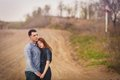 Couple hugging outdoors beautiful young embracing holding hands they stand on the dirt road Royalty Free Stock Images