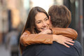 Couple hugging in the street portrait of a happy with women face foreground Stock Image