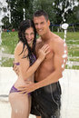 Couple hugging in a water park at swimming pool love public Royalty Free Stock Photography