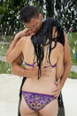 Couple hugging in a water park at swimming pool love public Stock Images