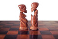 Couple, husband and wife ,represented by two pieces of wooden chess, king and queen , facing each other. Royalty Free Stock Photo