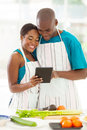 Couple internet recipe portrait of african using the to look up for a Royalty Free Stock Images