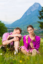 Couple with issues in Alpine meadow Royalty Free Stock Photo