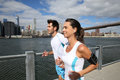 Couple of joggers by hudson river Royalty Free Stock Photo
