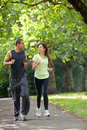 Couple jogging outdoors Stock Images