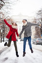 Couple jumping in snow Royalty Free Stock Photography