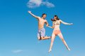 Couple jumping together Royalty Free Stock Photo