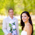 Couple just married with man holding flowers Royalty Free Stock Photography