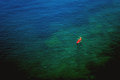 Couple kayaking in wide blue sea as seen from above tilt shift lens used Stock Photography