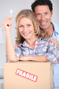 Couple with key to new home Royalty Free Stock Photo