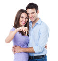 Couple with the keys of the new home over white background Stock Images
