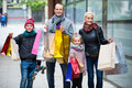Couple with kids on city street family and shopping bags Royalty Free Stock Photography