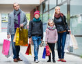 Couple with kids on city street family and shopping bags Royalty Free Stock Photo