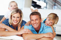 Couple with kids relaxing at home Royalty Free Stock Images