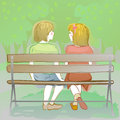 couple of kids sitting on a park bench Royalty Free Stock Photo