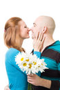 Couple kissig holding flowers Stock Image