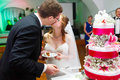Couple is kissing on the background amazing tasty cake decorated Royalty Free Stock Photo