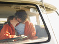 Couple Kissing In Campervan