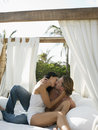 Couple Kissing On Four-Poster Bed Royalty Free Stock Photo